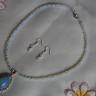 """,,Finete"""", set compus din colier si cercei, realizat din pietre mici (4 mm) de opalit, pandantiv din opalit incrustat cu zirconii transparente; accesorii metalice placate cu argint, iar tortitele cerceilor sunt din argint 925, marcat; colierul se asaza frumos la baza gatului; UNICAT; VANDUT"""
