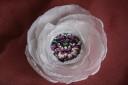 """Flori mov, floare realizata din petale de voal alb creponat si avand in centru o pata superba de culoare, in ,,persoana"""" unei minunate flori mov:); diametrul: cca 9-10 cm; se prinde cu ac de brosa argintiu"""