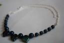 """,,Frunzulite cu dichis"""", colier foarte frumos realizat din perle Swarovski bleumarin si frunzulite din sticla de Cehia in acceasi nuanta, dar cu reflexe multicolore, si margelute toho crem; accesorii metalice placate cu argint si lant din otel argintat; lungime: finut, se asaza la baza gatului (45 cm desfasurat); UNICAT; VANDUT"""