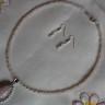 """,,Gratie de cuart"""", set compus din colier si cercei, realizat din pietre de cuart roz; colierul se asaza frumos la baza gatului, este foarte finut, cu pietre mici (4 mm) si pandantiv din cuart cu zirconii transparente; accesoriile metalice sunt placate cu argint, iar tortitele cerceilor sunt din argint 925, marcat; UNICAT; VANDUT"""