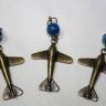""",,Martisoare-avioane"""", comanda speciala de la un domn director la Tiriac Air pentru 60 de doamne fericite:); avioanele sunt realizate din bronz si metal auriu antichizat si sunt ,,imblanzite"""" de cate o agata albastra in degradeuri, simbolizand zborul lor catre cer (2013)"""