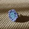 Inel textil, reglabil, culoare albastra si cu un manunchi de margele de nisip bleu sidef, diam. 2,5 cm; VANDUT, se poate reface la comanda
