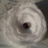 2012-Martisor-brosa textila; se prinde cu ac argintiu de brosa si se poate purta si dupa trecerea Martisorului; diametrul cca. 6 cm; martisorul vine impreuna cu un cartonas si snur de matase alb-rosu, totul ambalat in punguta speciala dedicata acestei sarbatori